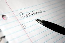 pen writing the word resolutions