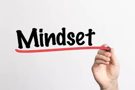 hand writing the word mindset