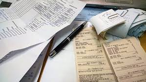 pen and receipts on table