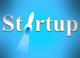 the word startup with rocket flying through it