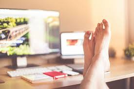 feet up on desk with laptop