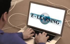 man on laptop that says e-learning